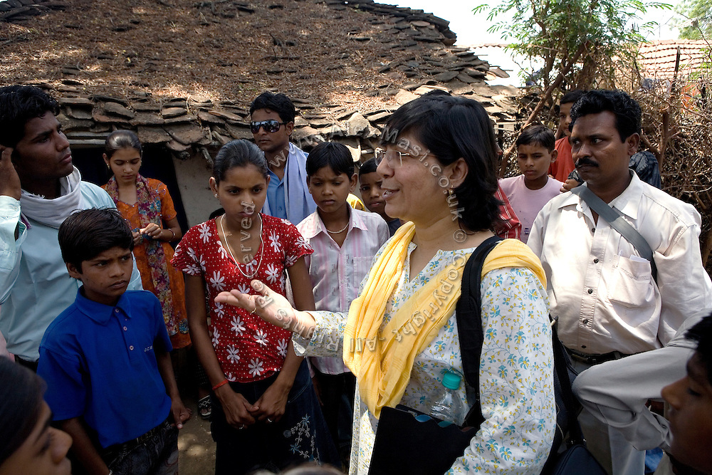 Veena Bandyopadhyay, a senior member of the Unicef team in Madhya Pradesh, India, is talking to Pooja, 14, a student from the village of Pathpuri and to other villagers during a visit to their child reporter project in Hoshangabad, the village district. The project was launched in collaboration with Dalit Sangh, an NGO which has been working for the uplift of scheduled castes for the past 22 years.