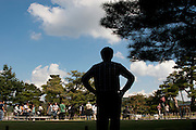 A tourist, in silhouette, enjoys the view in Kenrokuen Gardens, Kanazawa, Japan Wednesday October 15th 2008