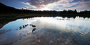 Reflections and ducks on Little Molas Lake in the Colorado Rockies, CO