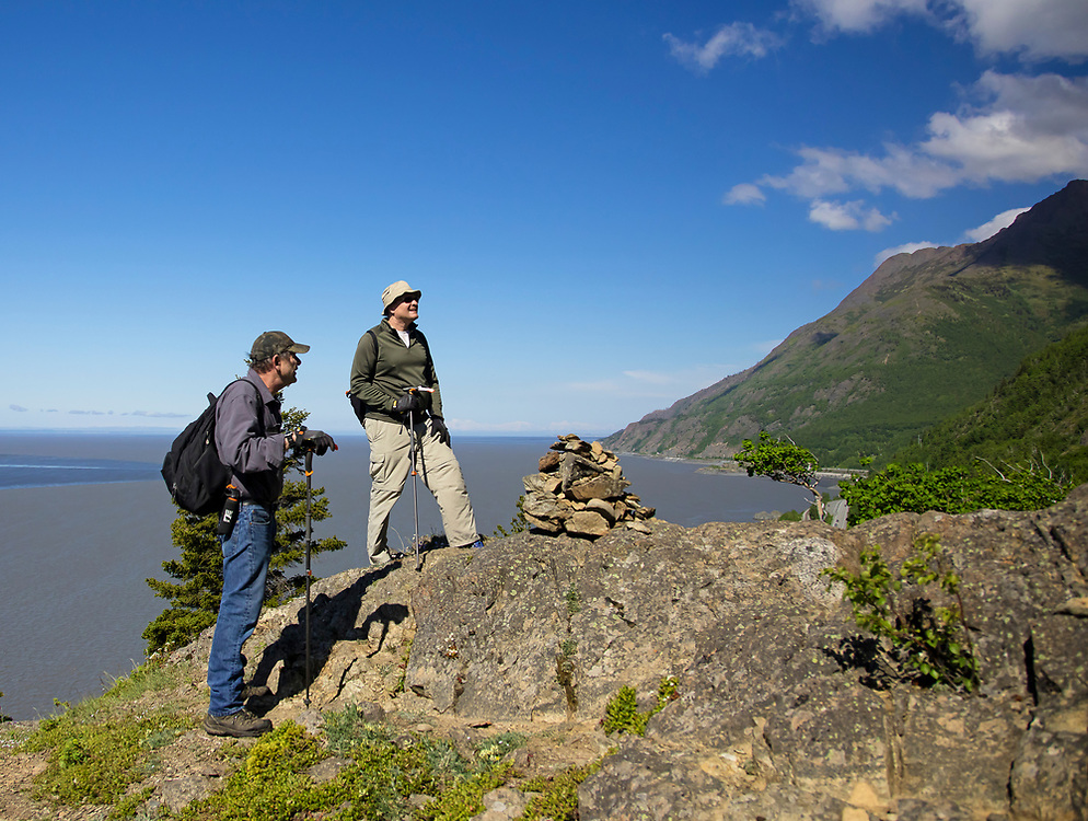 Summer scenic of men hiking along the Turnagain Arm/Cook Inlet in June (Model Releases)