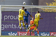 Oxford United defender 9on loan from Everton) Luke Garbutt (3) heads the ball  at goal during the EFL Sky Bet League 1 match between Oxford United and AFC Wimbledon at the Kassam Stadium, Oxford, England on 13 April 2019.