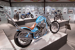 Mondo Porras' custom S&S KN93 Knucklehead tribute to Indian Larry on display in the More Mettle - Motorcycles and Art That Never Quit exhibition in the Buffalo Chip Events Center Gallery during the Sturgis Motorcycle Rally. SD, USA. Tuesday, August 10, 2021. Photography ©2021 Michael Lichter.