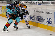 05.03.2011, Rapperswil-Jona, Eishockey NLA, Rapperswil-Jona Lakers - HC Lugano, Sven Berger (LAK) gegen Brady Murray (LUG)  (Thomas Oswald/hockeypics)