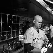 Brian McCann, New York Yankees, in the dugout preparing to bat during the New York Mets Vs New York Yankees MLB regular season baseball game at Citi Field, Queens, New York. USA. 20th September 2015. Photo Tim Clayton