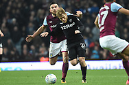 Leeds United midfielder Samu Saiz (21)  battles with Aston Villa midfielder Robert Snodgrass (7) during the EFL Sky Bet Championship match between Aston Villa and Leeds United at Villa Park, Birmingham, England on 13 April 2018. Picture by Alan Franklin.