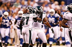 Philadelphia Eagles linebacker Akeem Jordan #56 is congratulated by safety Quintin Mikell #27 after a play during the NFL game between the Philadelphia Eagles and the Indianapolis Colts on August 20th 2009. The Colts won 23 to 15 at Lucas Oil Stadium in Indianapolis, IN.  (Photo By Brian Garfinkel)
