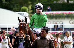 Jockey Richard Kingscote celebrates on Arthur Kitt after winning the Chesham Stakes during day five of Royal Ascot at Ascot Racecourse.