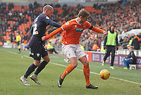 Blackpool's Steven Davies in action with Millwall's Alan Dunne<br /> <br /> Photographer Mick Walker/CameraSport<br /> <br /> Football - The Football League Sky Bet Championship - Blackpool v Millwall - Saturday 10th January 2015 - Bloomfield Road - Blackpool <br /> <br /> © CameraSport - 43 Linden Ave. Countesthorpe. Leicester. England. LE8 5PG - Tel: +44 (0) 116 277 4147 - admin@camerasport.com - www.camerasport.com