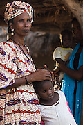 An elderly woman holds a young girl in the village of Darou Hidjeratou on Tuesday June19, 2007.
