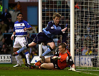 Photo. Glyn Thomas.<br /> Coventry City v Reading. Nationwide Division 1.<br /> Highfield Road, Coventry. 27/03/2004.<br /> Coventry's Gary McSheffrey (C) pulls a goal back for the home side, sending the ball past Reading keeper Jamie Ashdown (R).