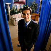 Michael Essany stands on the set of his cable television talk show that he has hosted since he was 14 from his parents' living room in the small town of Valparaiso, Indiana. The show has gained an international audience since being broadcasted by E! Entertainment television in the U.S. and Channel 4  in England. © 2003 photo by John Zich