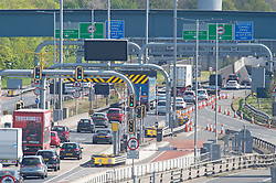 © Licensed to London News Pictures 30/04/2021. Dartford, UK. Cars heading into the Dartford Crossing tunnels in Kent. Motorists have been warned to expected delays on the road this May Bank holiday weekend as a total of 14 million getaway journeys are possible after a poll by the RAC. Saturday could be the busiest day on the roads in years due to coronavirus lockdown easing. Photo credit:Grant Falvey/LNP