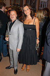 Fashion designer JACQUES AZAGURY and ELLA KRASNER at a party to celebrate 100 years of Chinese Cinema hosted by Shangri-la Hotels and Tartan Films at Asprey, New Bond Street, London on 25th April 2006.<br /><br />NON EXCLUSIVE - WORLD RIGHTS