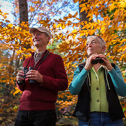 A couple birdwatching at Mayor Baxter Woods in Portland, Maine.
