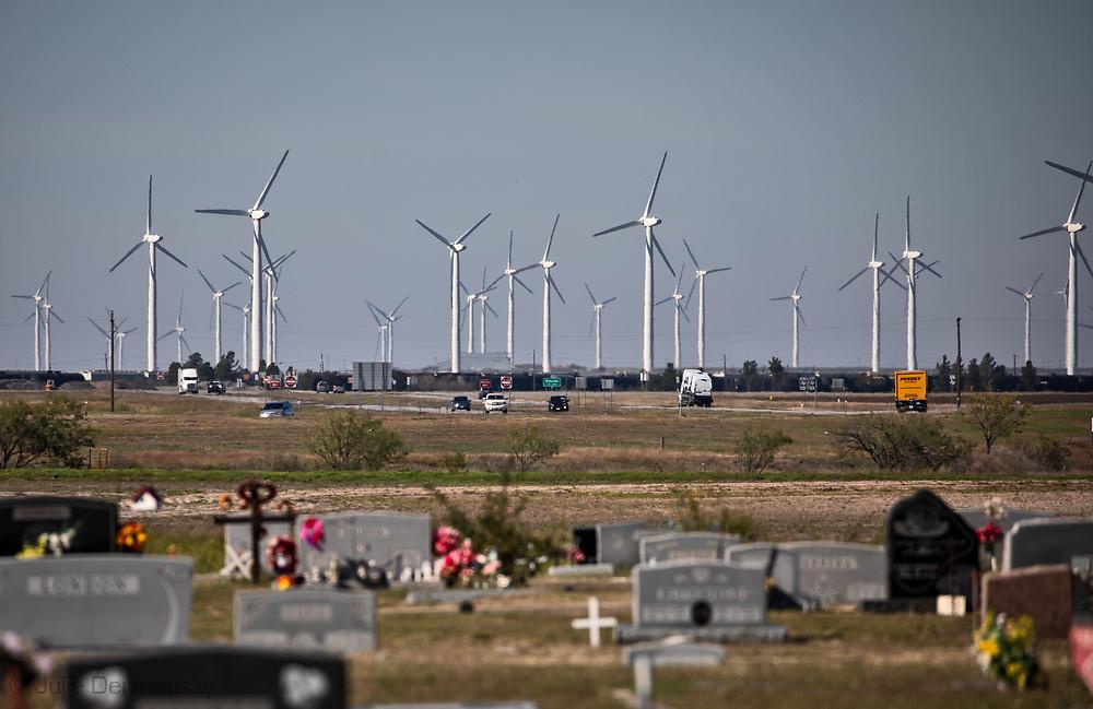 Cemetery next to  a wind energy farm in Roscoe Texas.