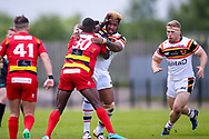 Dewsbury Rams Daniel Igbinedion (30) is tackled by Bradford Bulls loose forward Ross Peltier (17) during the Kingstone Press Championship match between Dewsbury Rams and Bradford Bulls at the Tetley's Stadium, Dewsbury, United Kingdom on 4 June 2017. Photo by Simon Davies.