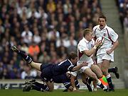 Twickenham, Surrey, 22nd March 2003,  RFU Twickenham Stadium, England, [Mandatory Credit; Peter Spurrier/Intersport Images]<br /> <br /> RBS Six Nations Rugby England v Scotland<br /> Josh Lewsey is tackled by Scott Murray.