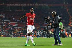11th May 2017 - UEFA Europa League - Semi Final (2nd Leg) - Manchester United v Celta Vigo - A television (TV) cameraman films Paul Pogba of Man Utd as he celebrates victory - Photo: Simon Stacpoole / Offside.