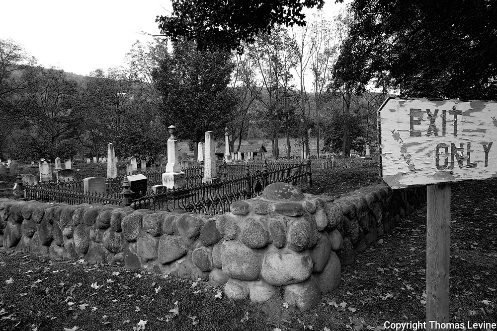 Naples, New York: Exit Sign in Black and White in a old cemetery, uppersate NY.