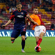 Galatasaray's Burak Yilmaz (R) and Mersin idman Yurdu's Milan Mitrovic (L) during their Turkish Super League soccer match Galatasaray between Mersin idman Yurdu at the AliSamiYen Spor Kompleksi TT Arena at Seyrantepe in Istanbul Turkey on Saturday, 12 September 2015. Photo by Kurtulus YILMAZ/TURKPIX
