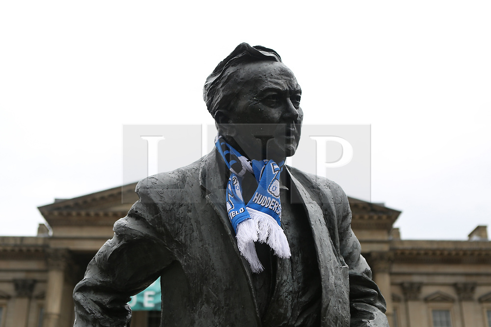 © Licensed to London News Pictures. 30/05/2017. Huddersfield, UK. The statue of Harold Wilson in St Georges Square is adorned with Huddersfield Town scarf. Huddersfield Town will celebrate with an open top bus this evening after successfully gaining promotion to the Premier League for the first time yesterday. Underdogs Huddersfield beat Reading on penalties at Wembley yesterday to take their place in the Premier League ending a 45 year absence from the top flight of English football. Photo credit : Ian Hinchliffe/LNP