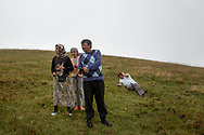 Yilmaz Civelek (centre right), Muazzez Kocek (left) and Ayla 12, (centre left) load bullets into a handgun near their village of Alaca Yaylası, high in Turkey's northern Pontic mountains. Villagers communicate using a language of whistling across the surrounding hills.