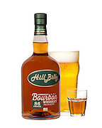 Bottle of bourbon with a glass of beer and a shot