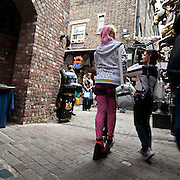 Camden Lock Market is situated by the Regent's Canal occupying some outdoor areas by the canal and various existing buildings. It attracted large numbers of visitors with stalls selling books, new and second-hand clothing, and jewellery. It is built in a traditional style, and is almost indistinguishable from the 19th century industrial architecture and housing in the area.