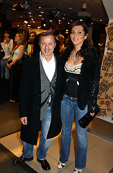 Fashion designer JACQUES AZAGURY and ELLA KRASNER at a Topshop hosted Jumbo Thrift Sale - a sale of designer fashion, in association with the Terence Higgins Trust for World Aids Day, held at Topshop, Oxford Circus, London on 1st December 2004.<br /><br />NON EXCLUSIVE - WORLD RIGHTS