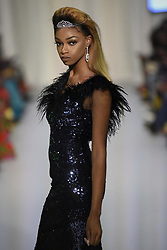 August 18, 2017 - Toronto, Ontario, Canada - A model showcasing  clothes of designer  ''SmailAkdim Couture'' during the African Fashion Week in Toronto, Canada on 18 August 2017. (Credit Image: © Arindam Shivaani/NurPhoto via ZUMA Press)