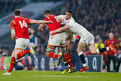 Wales Number 8 Taulupe Faletau is tackled by England Winger Anthony Watson and Inside Centre Owen Farrell - Mandatory byline: Rogan Thomson/JMP - 12/03/2016 - RUGBY UNION - Twickenham Stadium - London, England - England v Wales - RBS 6 Nations 2016.
