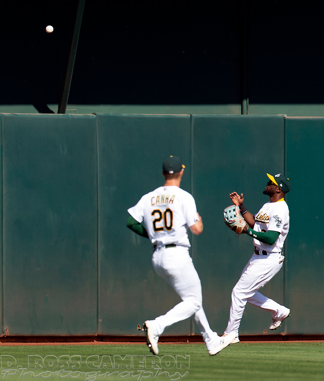 Sep 26, 2021; Oakland, California, USA; Oakland Athletics center fielder Starling Marte (2) runs down an RBI double by Houston Astros first baseman Yuli Gurriel in the sixth inning at RingCentral Coliseum. Mandatory Credit: D. Ross Cameron-USA TODAY Sports