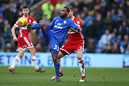 Junior Hoilett of Cardiff city (l) gets to the ball ahead of Ben Gibson of Middlesbrough.EFL Skybet championship match, Cardiff city v Middlesbrough at the Cardiff city Stadium in Cardiff, South Wales on Saturday 17th February 2018.<br /> pic by Andrew Orchard, Andrew Orchard sports photography.