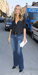 Gwyneth Paltrow at the Calvin Klein fashion show during the New York Fashion Week.  Full length, jeans, demin, long wavy hair, low neck line.