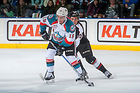KELOWNA, CANADA - FEBRUARY 10:Tyler Popowich #13 of the Vancouver Giants back checks Dillon Dube #19 of the Kelowna Rockets as he skates with the puck  on February 10, 2017 at Prospera Place in Kelowna, British Columbia, Canada.  (Photo by Marissa Baecker/Shoot the Breeze)  *** Local Caption ***