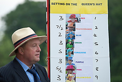 © London News Pictures. 18/06/2013. Ascot, UK.  A bookmaker offering odds on the colour of the queens hat  on day one of Royal Ascot at Ascot racecourse in Berkshire, on June 18, 2013.  The 5 day showcase event,  which is one of the highlights of the racing calendar, has been held at the famous Berkshire course since 1711 and tradition is a hallmark of the meeting. Top hats and tails remain compulsory in parts of the course. Photo credit should read: Ben Cawthra/LNP