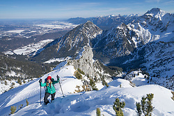 Woman ski touring in back country, Bavaria, Germany