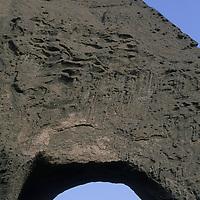 A mountaineer stands atop Shipton's Arch in the Kara Tagh Mountains near Kashgar, Xinjiang, China.
