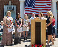 Wantagh, New York, USA. July 4, 2016. Standing L-R, EMMA CAREY; BRIANNA COLTELLINO; KERI BALNIS, Miss Wantagh 2015; STEVE RHOADS, Nassau County Legislator District 19; ERIN KING-SWEENEY, Town Councilwoman; and ELLA STEVENS, Miss Wantagh Pageant coordinator; at the 60th Annual Miss Wantagh Pageant, an Independence Day tradition on Long Island. O'Connell is opening envelope to find who Miss Wantagh 2016 is - Emma or Brianna. Since 1956, the Miss Wantagh Pageant, which is not a beauty pageant, crowns an area high school student based mainly on academic excellence and community service.