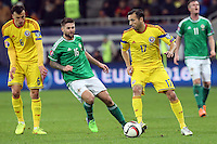 ROMANIA, Bucharest : Romania's Lucian Sanmartean (R) and Northern Ireland's Oliver Norwood (L) vie for the ball during the Euro 2016 Group F qualifying football match Romania vs Northern Ireland in Bucharest, Romania on November 14, 2014.