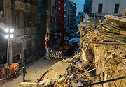Rescue worker uses the crane to get up into the site on Friday 4 Aug 2020. A building collapsed from the Beirut Port explosion, trapping two bodies underneath the rubble. (VXP Pictures/ Matt Kynaston)