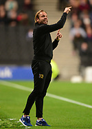 Robbie Neilson, the Scottish manager of Milton Keynes Dons instructs his players from the touchline. .EFL Skybet football league one match, MK Dons v Northampton Town at the Stadium MK in Milton Keynes on Tuesday 26th September 2017.<br /> pic by Bradley Collyer, Andrew Orchard sports photography.