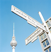 Street sign and the Fernsehturm Tower, Berlin, Germany