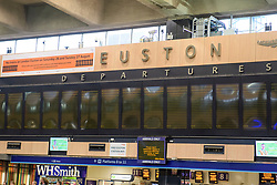 © Licensed to London News Pictures. 26/08/2017. London, UK. Empty departure boards at Euston station in London, which is closed over the bank holiday weekend for upgrade work.  .Passengers travelling over the bank holiday have been warned not to use trains as major engineering work affecting several lines is predicted to cause travel chaos. Photo credit: Ben Cawthra/LNP