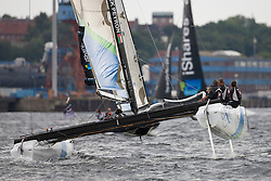 """© Sander van der Borch. Kiel - Germany, 27th of August 2009. iShares cup. Practice day...The first day of racing as part of the media day. the teams practice on the inland canal close to the city centre. The picture shows the Oman Sail extreme 40 """"Renaissance""""."""