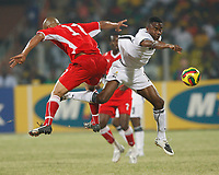 Photo: Steve Bond/Richard Lane Photography.<br />Ghana v Namibia. Africa Cup of Nations. 24/01/2008. Eric Addo (R) and Norman Jacobs (L) in mid air
