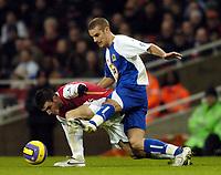 Photo: Olly Greenwood.<br />Arsenal v Blackburn Rovers. The Barclays Premiership. 23/12/2006. Blackburn's David Bentley tackles Arsenal's Cesc Fabregas