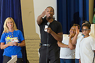 """Middletown, New York -  Maximilian Mezetin, center, speaks after children from the Middletown YMCA's Camp Funshine performed in """"The Show"""", a musical production, on Aug. 7, 2014. He wrote the show and was the musical director."""