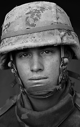 PFC Allan Michaels, 20, Rolla, Missouri, Weapons Platoon, Kilo Co., 3rd Battalion 1st Marines, United States Marine Corps, at the company's firm base in Haditha, Iraq on Sunday Oct. 22, 2005.