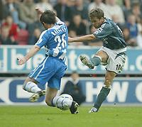 Photo: Aidan Ellis.<br /> Wigan Athletic v Newcastle United. The Barclays Premiership. 15/10/2005.<br /> newcastle's Michael Owen has his shot blocked by Wigan's Leighton Baines